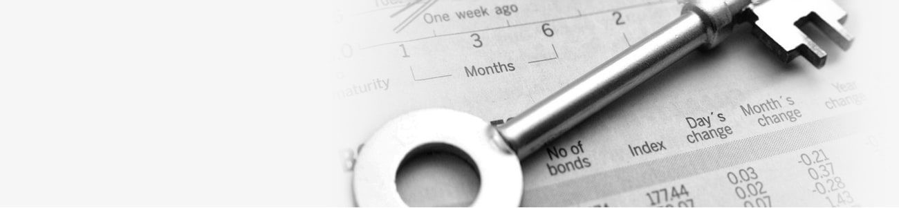 Banner picture of a key atop a balance sheet